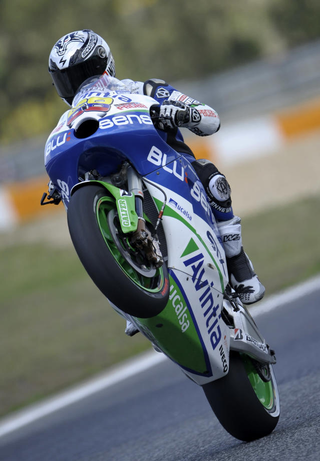 Avintia Blusens team's rider Colombian Yonny Hernandez makes a wheelie at the end of the Moto GP qualifying practice of the Portuguese Grand Prix in Estoril, outskirts of Lisbon, on May 5, 2012. Australian Casey Stoner finished in first place, Spanish Dani Pedrosa was second and Cal Crutchlow third for tomorrow's start. AFP PHOTO / MIGUEL RIOPAMIGUEL RIOPA/AFP/GettyImages