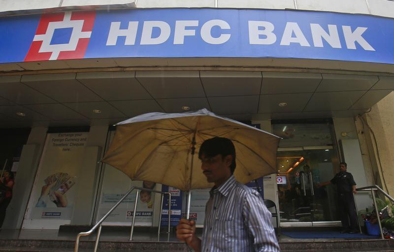 A customer walks outside an HDFC Bank branch in Mumbai