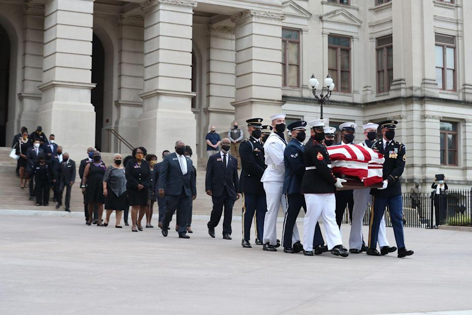 <p>An honor guard, followed by the Georgia Black Caucus, carried Congressman Lewis's casket out of the Georgia State Capitol on the day of Lewis's funeral. </p>