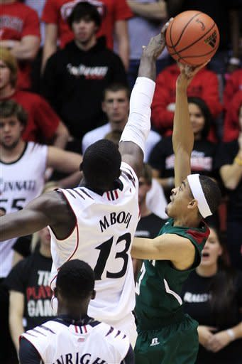 Cincinnati center Cheikh Mbodj (13) blocks a shot by Mississippi Valley State guard Darryl Marshall in the first half of an NCAA college basketball game, Tuesday, Nov. 13, 2012, in Cincinnati. (AP Photo/Al Behrman)