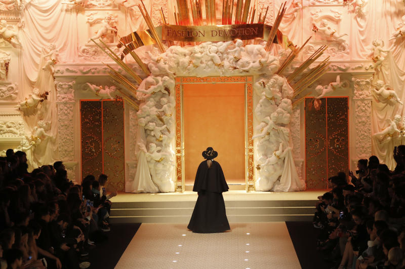 <p> A model wears a creation as part of the Dolce & Gabbana women's Fall/Winter 2018-2019 collection, presented during the Milan Fashion Week, in Milan, Italy, Sunday, Feb. 25, 2018. (AP Photo/Antonio Calanni)