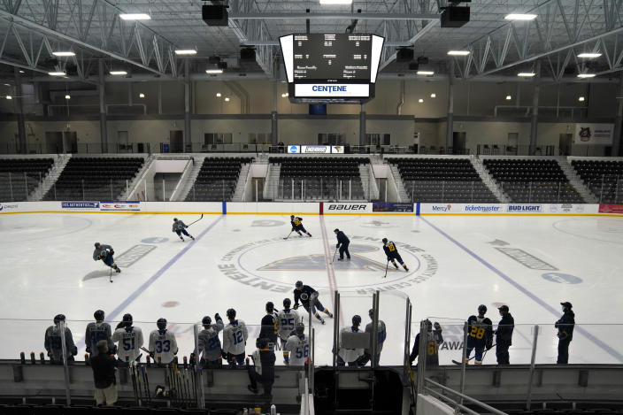 Members of the St. Louis Blues practice during NHL hockey training camp Tuesday, Jan. 5, 2021, in Maryland Heights, Mo. (AP Photo/Jeff Roberson)