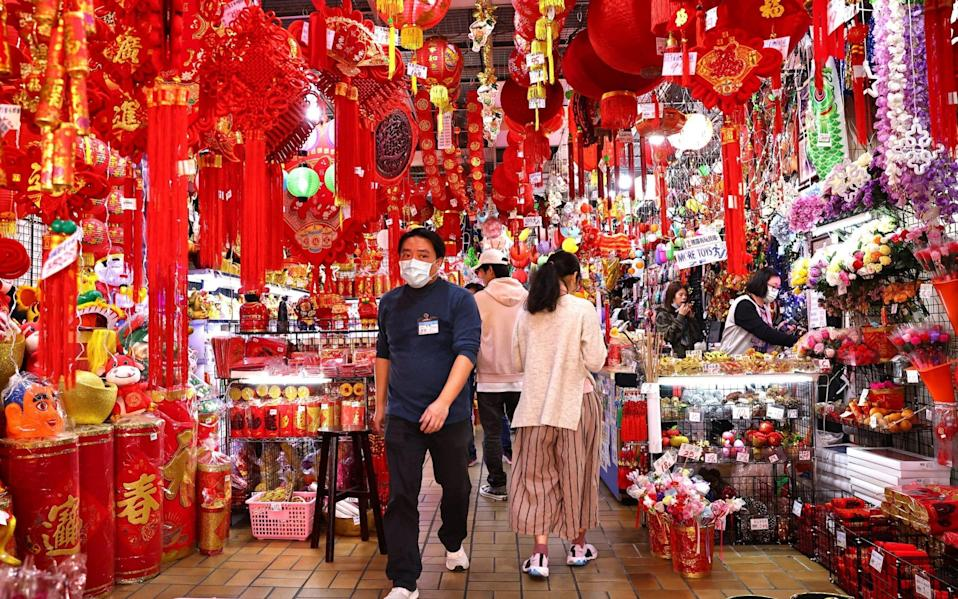 Mask-wearing shoppers in Taipei, Taiwan ahead of the Chinese New Year - Reuters