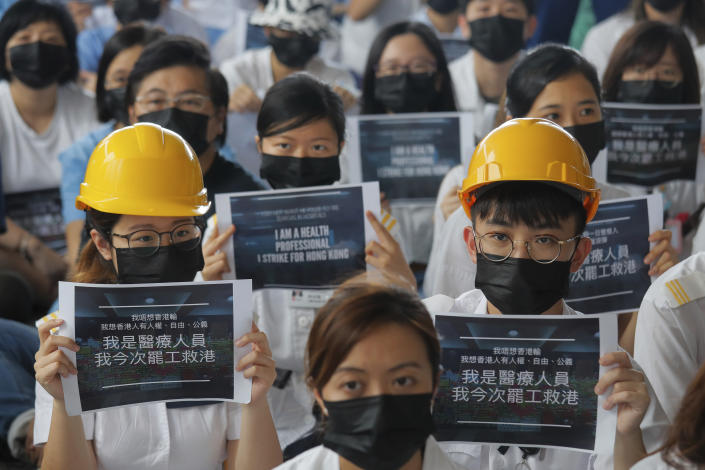 Medical staff take part in a protest against police brutality on the protesters, at a hospital in Hong Kong, Tuesday, Aug. 13, 2019. (Photo: Kin Cheung/AP)