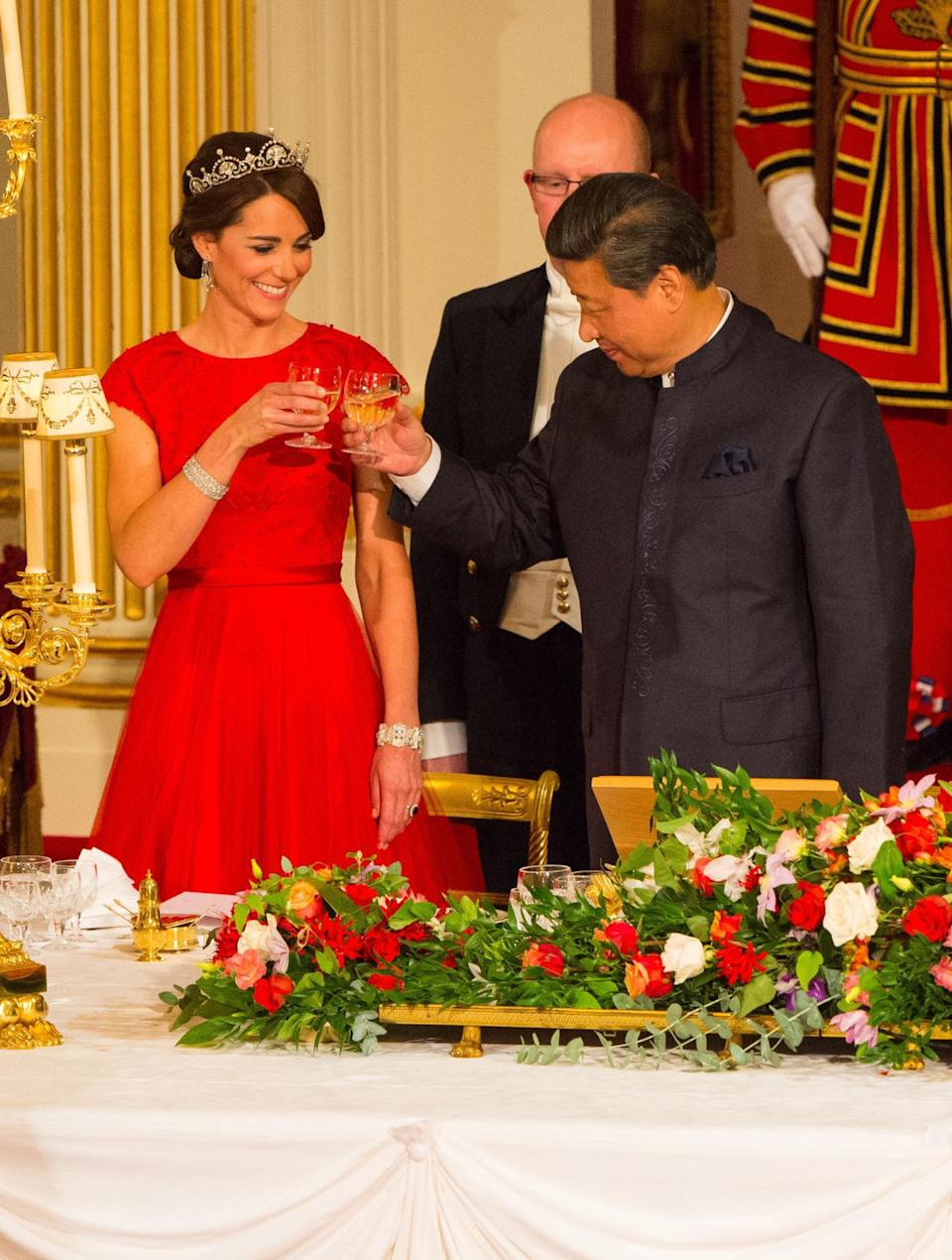 <p>Attending a state banquet in Buckingham Palace for the President of China, Kate went for a beautiful red Jenny Packham gown along with the Lotus Flower tiara - symbolic of China's culture. </p><p><i>[Photo: PA]</i></p>