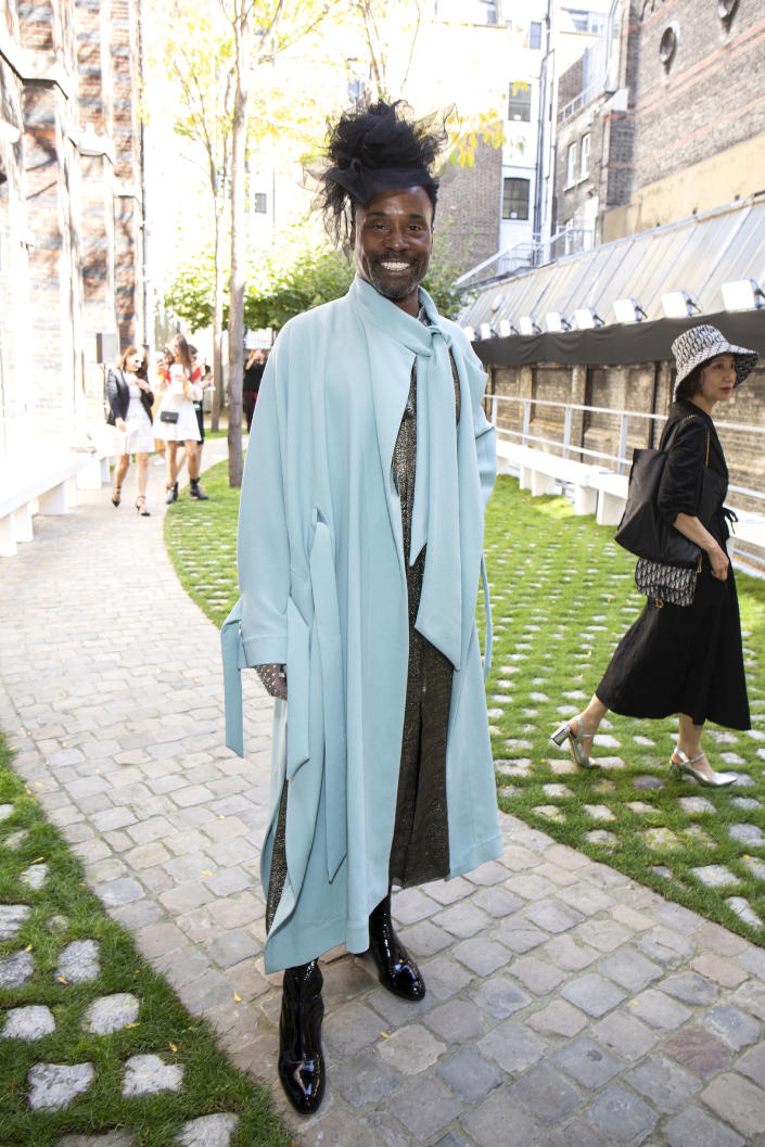 Billy donned a sky blue cape with a glittering silver jumpsuit underneath which he styled with a black fascinator at the Roland Mouret SS20 show [Photo: Getty Images]
