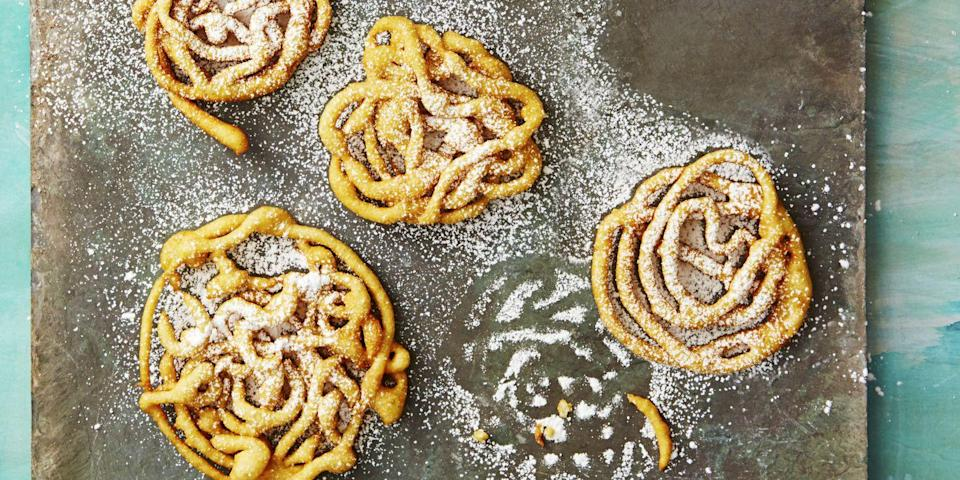 """<p>Summer's most iconic sweet treat doesn't have to take hours to master. This pancake-mix shortcut recipe takes only 25 minutes to make fried and fluffy funnel cakes.</p><p><em><a href=""""https://www.goodhousekeeping.com/food-recipes/dessert/a38822/shortcut-funnel-cakes-recipe/"""" rel=""""nofollow noopener"""" target=""""_blank"""" data-ylk=""""slk:Get the recipe for Shortcut Funnel Cakes »"""" class=""""link rapid-noclick-resp"""">Get the recipe for Shortcut Funnel Cakes »</a></em></p>"""