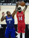 Los Angeles Clippers forward Kawhi Leonard (2) defends against New Orleans Pelicans forward Brandon Ingram (14) during the first quarter of an NBA basketball game Wednesday, Jan. 13, 2021, in Los Angeles. (AP Photo/Ashley Landis)