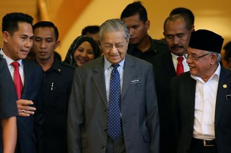 Malaysia's Prime Minister Mahathir Mohamad leaves after a news conference in Putrajaya