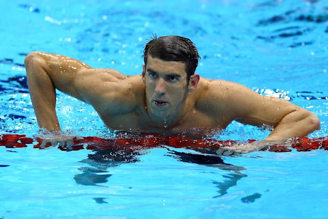 Michael Phelps of the United States exits the pools afer winning the Men?s 100m Butterfly Final on Day 7 of the London 2012 Olympic Games at the Aquatics Centre on August 3, 2012 in London, England. (Photo by Paul Gilham/Getty Images)