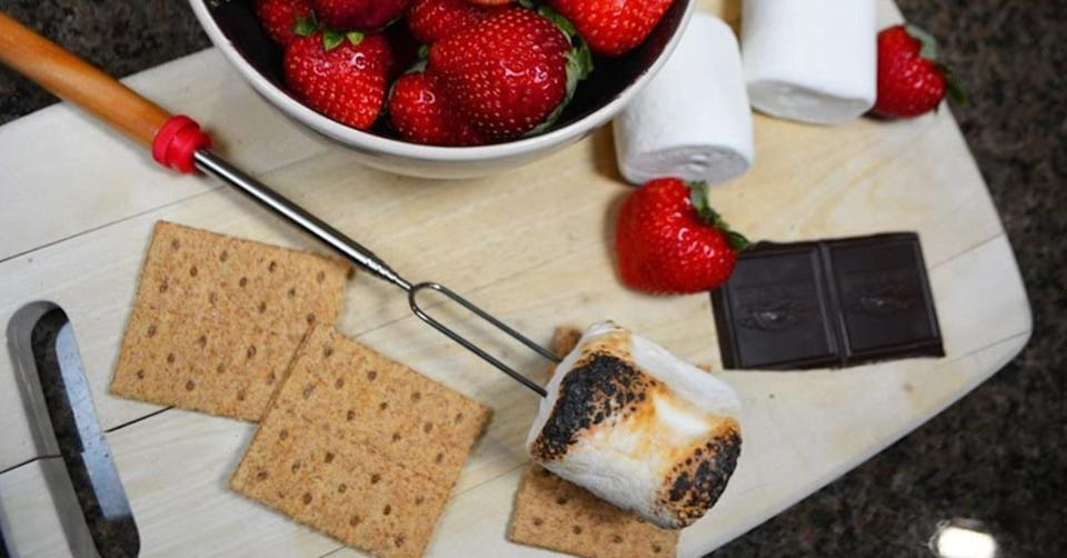 """If you're having a backyard s'mores night, your marshmallows will get nice and toasty without creating a goopy mess.Each roasting stick comes with two prongs and material that doesn't warm up too much.<br /><br /><strong>Promising review:</strong>""""I have other telescopic roasting sticks but bought these ones because I find the prong on my other ones a bit too widely spaced.<strong>These ones are perfect for roasting a single marshmallow, holding one on two prongs so that it doesn't rotate as it gets warm. The tips are dull, so they are ideal for young kids to use safely.</strong>The pole has a nice rubber end to hold and the metal does not get warm all the way up so it keeps your hand safe. The length of them is great."""" —<a href=""""https://amzn.to/2PiJSxo"""" target=""""_blank"""" rel=""""nofollow noopener noreferrer"""" data-skimlinks-tracking=""""5580838"""" data-vars-affiliate=""""Amazon"""" data-vars-href=""""https://www.amazon.com/gp/customer-reviews/R3CGEJPD908Y51?tag=bfgenevieve-20&ascsubtag=5580838%2C19%2C33%2Cmobile_web%2C0%2C0%2C1159936"""" data-vars-keywords=""""cleaning"""" data-vars-link-id=""""1159936"""" data-vars-price="""""""" data-vars-product-id=""""16176882"""" data-vars-retailers=""""Amazon"""">Amazon Customer</a><br /><br /><strong>Get an 8-pack from Amazon for<a href=""""https://amzn.to/3sRT0a5"""" target=""""_blank"""" rel=""""nofollow noopener noreferrer"""" data-skimlinks-tracking=""""5580838"""" data-vars-affiliate=""""Amazon"""" data-vars-asin=""""B071NP7R23"""" data-vars-href=""""https://www.amazon.com/dp/B071NP7R23?tag=bfgenevieve-20&ascsubtag=5580838%2C19%2C33%2Cmobile_web%2C0%2C0%2C1159975"""" data-vars-keywords=""""cleaning"""" data-vars-link-id=""""1159975"""" data-vars-price="""""""" data-vars-product-id=""""15928352"""" data-vars-product-img=""""https://m.media-amazon.com/images/I/41ItOOH5aJL.jpg"""" data-vars-product-title=""""Ajmyonsp Marshmallow Roasting Sticks with Wooden Handle Extendable Forks Set of 5Pcs Telescoping Smores Skewers for Campfire Firepit and Sausage BBQ, 32 Inch"""" data-vars-retailers=""""Amazon"""">$9.98+</a> (available in four colors).</strong>"""
