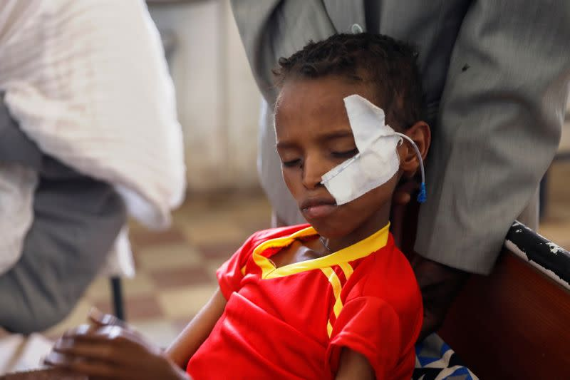 Fourteen-year-old Adan Muez is helped to sit up in his bed at Adigrat General Hospital in the town of Adigrat, Tigray region