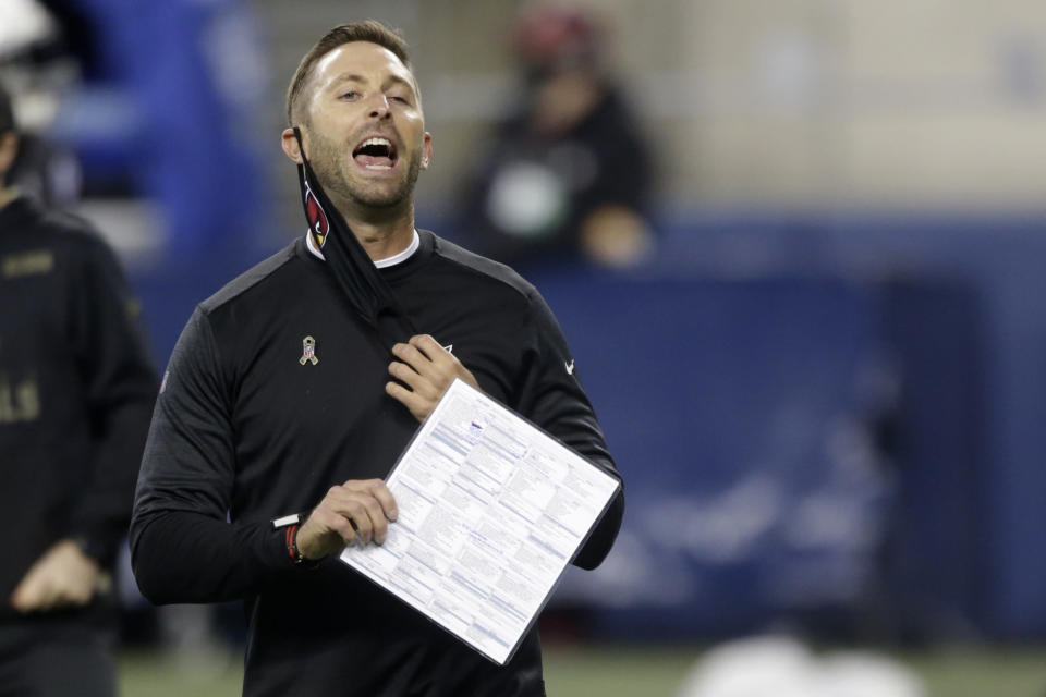 FILE - Arizona Cardinals head coach Kliff Kingsbury removes his mask to yell before an NFL football game against the Seattle Seahawks, Thursday, Nov. 19, 2020, in Seattle. The New England Patriots host the Cardinals on Sunday Nov. 29. With a win, Arizona can also add yet another blow to the New England's fading playoff hopes. (AP Photo/Lindsey Wasson)