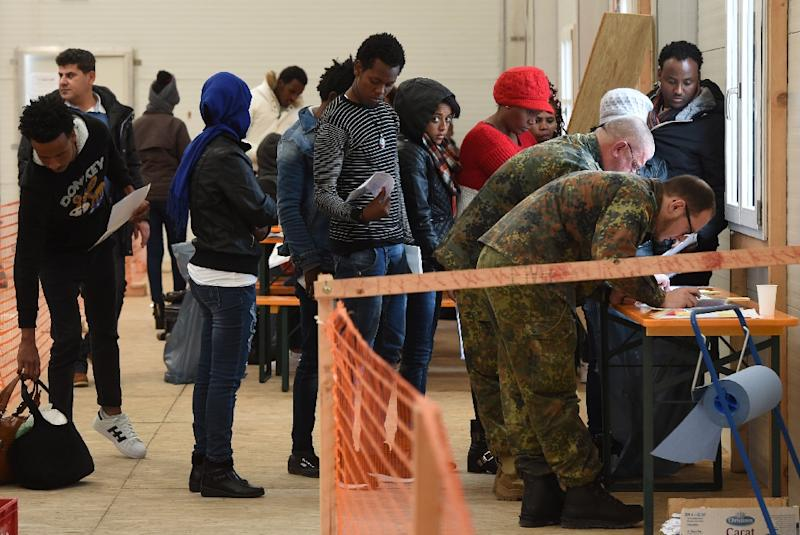Migrants queue at a registration point in the Bavarian town of Erding, in November 2016