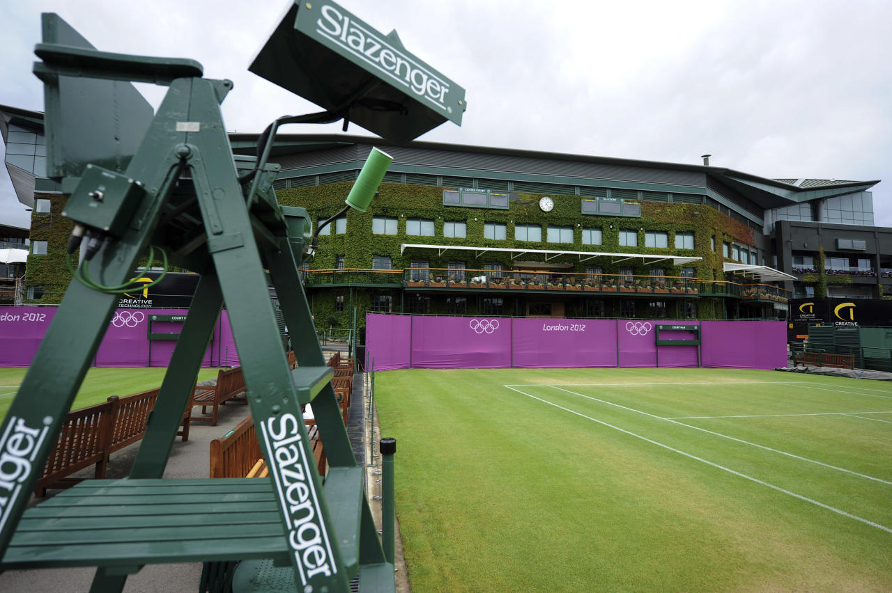 Olympic hoarding is seen on Court Six of the All England Lawn Tennis Club (AELTC) as preparations are made for the London 2012 Olympic Games, in London July 9, 2012.    REUTERS/Ki Price     (BRITAIN - Tags: SPORT OLYMPICS TENNIS)