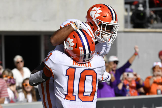 Clemson running back Darien Rencher (21) and wide receiver Joe Ngata (10) celebrate after Rencher scored a touchdown during the second half of an NCAA college football game in Louisville, Ky., Saturday, Oct. 19, 2019. Clemson won 45-10. (AP Photo/Timothy D. Easley)