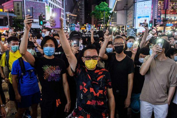 PHOTO: Pro-democracy activists hold up their mobile phone torches as they sing during a rally in the Causeway Bay district of Hong Kong on June 12, 2020. (Anthony Wallace/AFP via Getty Images)