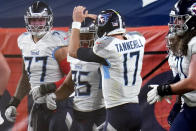 Tennessee Titans tight end MyCole Pruitt (85) celebrates his touchdown with quarterback Ryan Tannehill (17) during the first half of an NFL football game against the Denver Broncos, Monday, Sept. 14, 2020, in Denver. (AP Photo/Jack Dempsey)