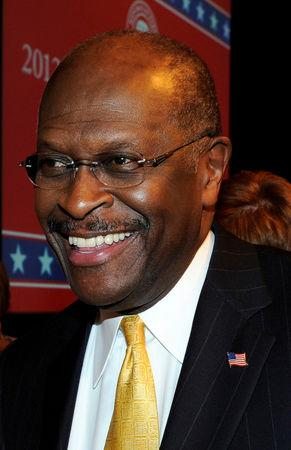 FILE PHOTO: Former U.S. presidential candidate Herman Cain smiles after endorsing Republican U.S. presidential candidate Newt Gingrich at the Kravis Center in West Palm Beach, Florida January 28, 2012. REUTERS/Doug Murray/File Photo