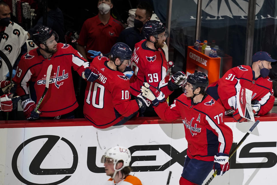 Washington Capitals right wing T.J. Oshie (77) celebrates his goal during the second period of an NHL hockey game against the Philadelphia Flyers, Friday, May 7, 2021, in Washington. (AP Photo/Alex Brandon)