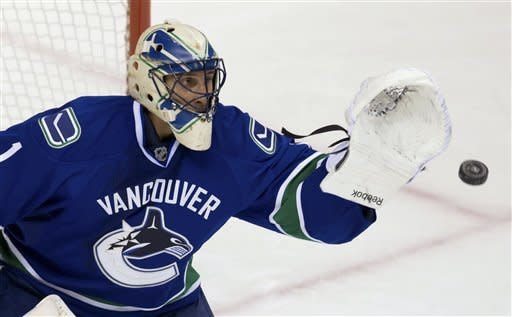 Vancouver Canucks goalie Roberto Luongo makes a glove save against the Edmonton Oilers during the second period of an NHL hockey game in Vancouver, British Columbia, on Sunday, Jan. 20, 2013. (AP Photo/The Canadian Press, Darryl Dyck)