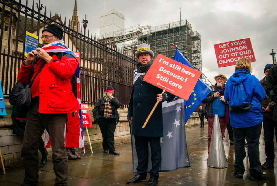 The campaigner wore a grey hat and flag cape on his 847th day of protest (SWNS)