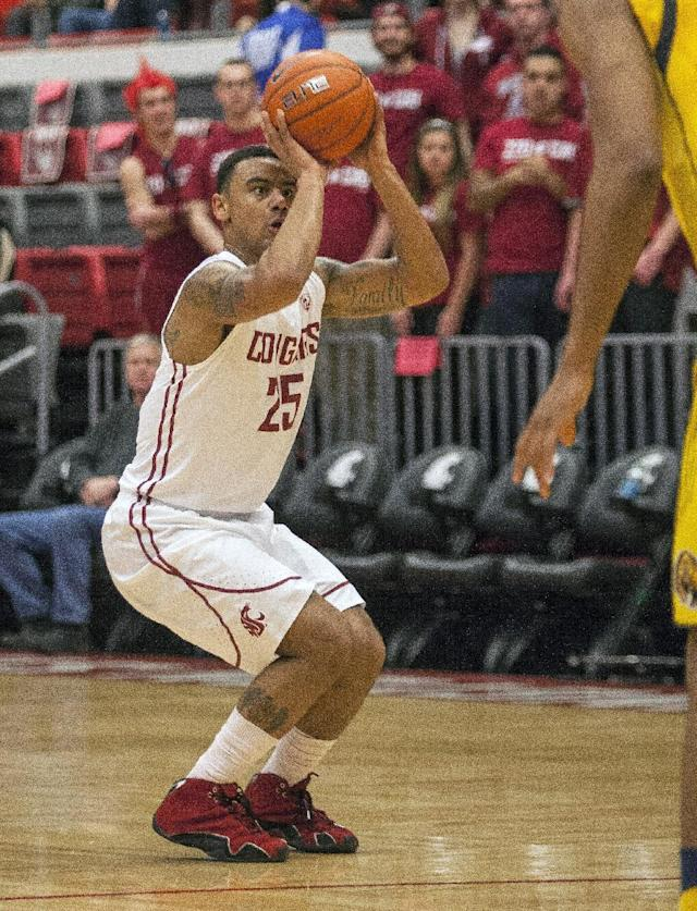 Washington State guard DaVonte Lacy (25) scores on this 3-point shot against California during the first half of an NCAA college basketball game Wednesday, Feb. 12, 2014, at Beasley Coliseum in Pullman, Wash. (AP Photo/Dean Hare)