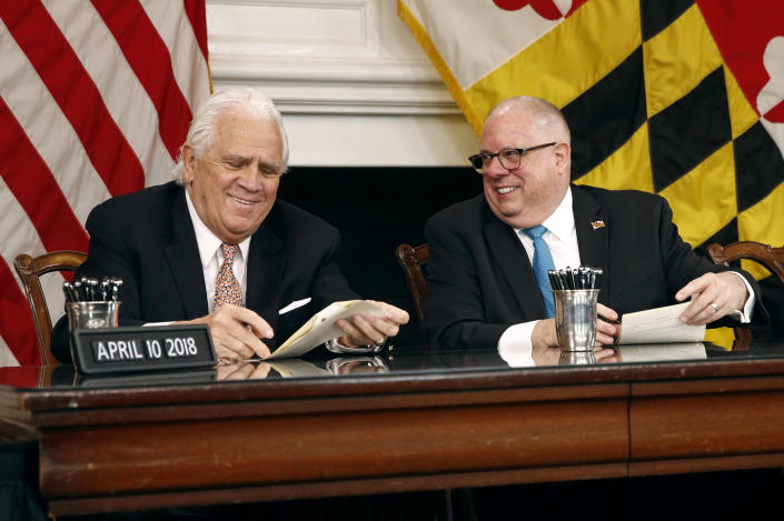 Democratic Senate President Thomas V. Mike Miller, left, and Maryland Gov. Larry Hogan laugh as they sign a series of bills during a ceremony in Annapolis, Md., Tuesday, April 10, 2018. The day after the state's 2018 legislative session wrapped up, Democrat and Republican state lawmakers highlighted bipartisan work in contrast to partisan gridlock in the nation's capital. (Patrick Semansky/AP)