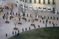 People wait in a line to undergo the coronavirus disease (COVID-19) test at a testing site at City Hall Plaza in Seoul