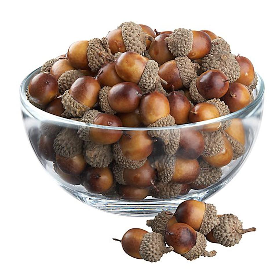 """<p>Don't forget to add small fall-inspired touches to the more understated corners of your home. A pretty glass bowl filled with rustic acorns makes any small space feel a little more festive. For a perfectly organic Thanksgiving tabletop, scatter acorns easily along the table's center line and weave small candles throughout.</p> <p><strong>To buy: </strong>$13; <a href=""""http://www.anrdoezrs.net/links/7876406/type/dlg/sid/RS%2CFallAccentsYou%2527llWantJustinTimeforThanksgiving%2Cmseaver805%2CDEC%2CIMA%2C680342%2C201910%2CI/https://www.crateandbarrel.com/oak-tree-acorns/s278076"""" target=""""_blank"""">crateandbarrel.com</a>.</p>"""