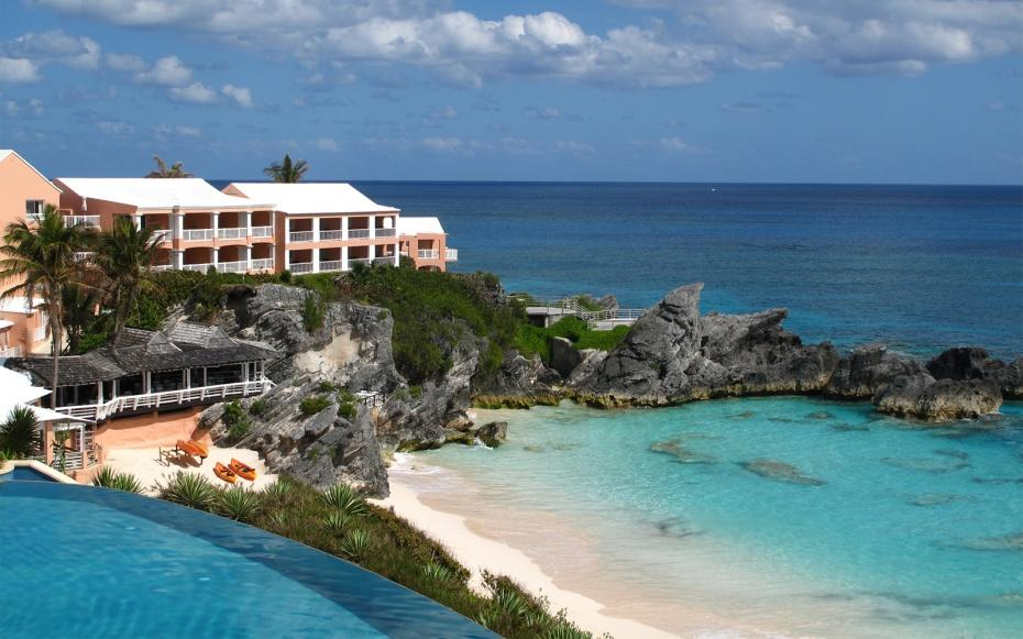"""Overlooking Bermuda's southern shore, <a rel=""""nofollow"""" href=""""http://www.travelandleisure.com/travel-guide/southampton/hotels/the-reefs-resort-club"""">this 62-room beachfront resort</a> sits on a secluded pink-sand beach, where guests are free to use stand-up paddleboards, snorkeling gear, and kayaks before recovering with a massage at the full-service La Serena spa. There are four restaurants from which to choose, and couples can arrange a romantic dinner for two right on the sand. Come summer, the property hosts regular events including live DJs on the terrace. Whether you come to party or relaxing stay, the Reefs has a reputation for greeting repeat guests (some of whom have returned to the property 45 times) like kin. FIX REP: """"The staff treated us like long-lost family,"""" remembered one WBA voter."""