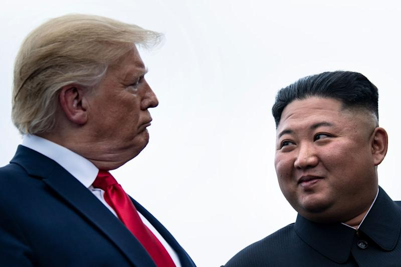 US President Donald Trump and North Korea's leader Kim Jong-un talk during a June meeting in 2019. Source: AP