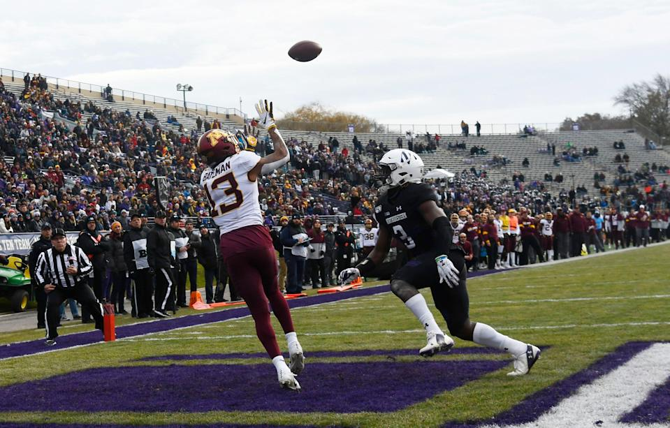 Nov 23, 2019; Evanston, IL, USA; Minnesota Golden Gophers wide receiver Rashod Bateman (13) catches a touchdown as Northwestern Wildcats defensive back Trae Williams (3) defends him during the second half at Ryan Field. Mandatory Credit: David Banks-USA TODAY Sports