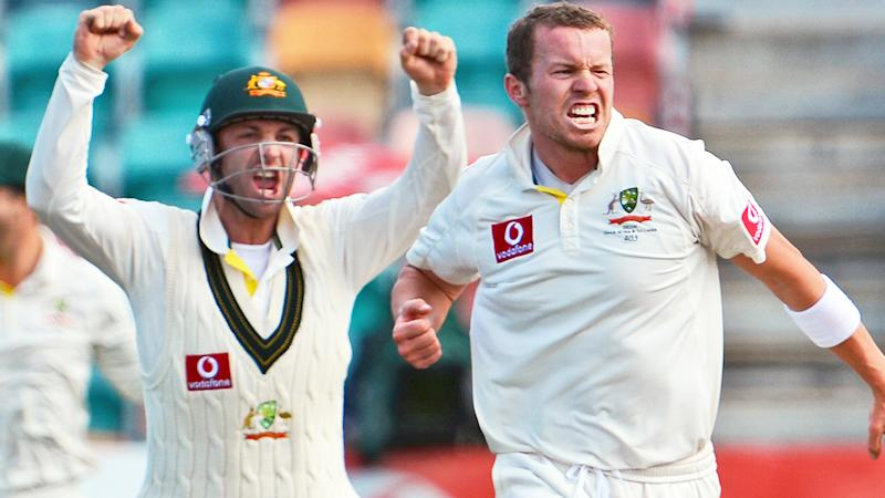 Peter Siddle (R) and Phillip Hughes, pictured here during a Test in 2012.