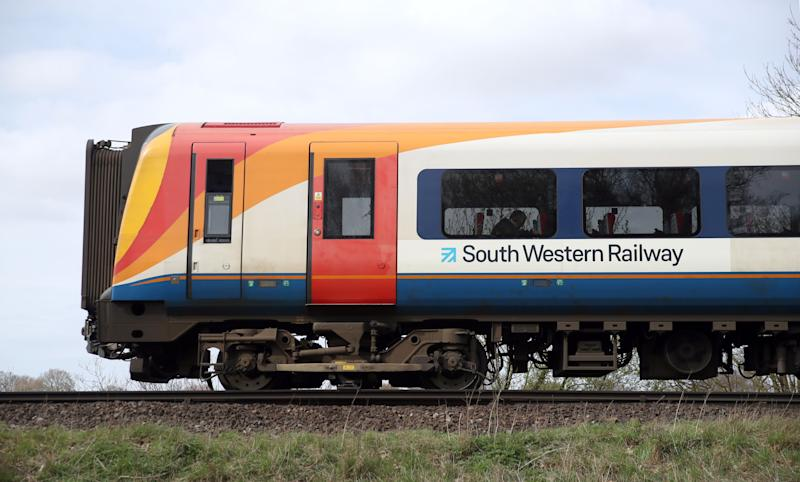 A South Western Railway train makes it's way along the line near to Basingstoke in Hampshire. (Photo by Andrew Matthews/PA Images via Getty Images)