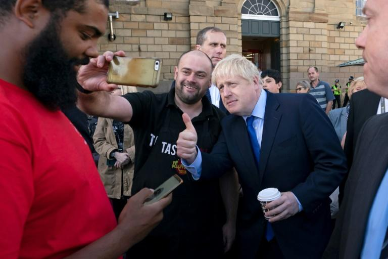 Boris Johnson risking being seen with a single-use cup during a visit to Doncaster last month