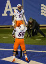 Boise State offensive lineman Jake Stetz, front, hoists wide receiver CT Thomas after Thomas' catch for a touchdown against Air Force in the second half of an NCAA college football game Saturday Oct. 31 2020, at Air Force Academy, Colo. (AP Photo/David Zalubowski)