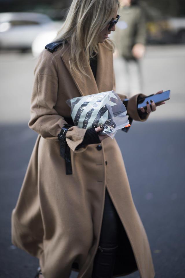 <p>Model carries an Off-White clear plastic zip bag. (Photo: Getty Images) </p>