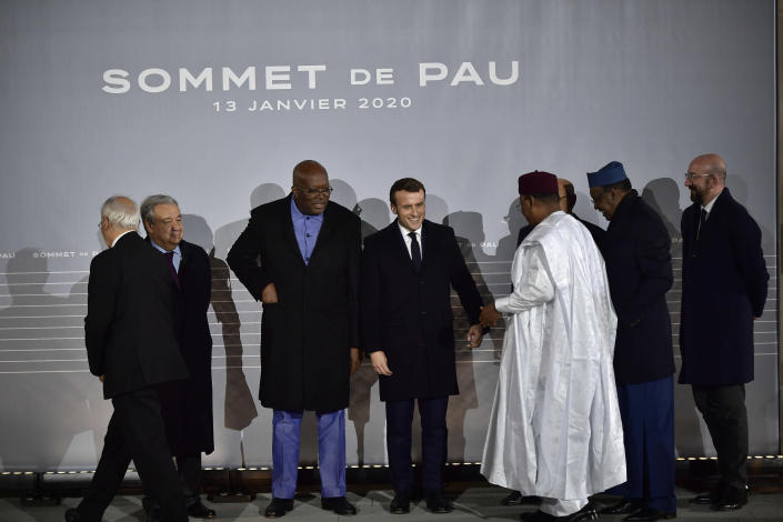 French President Emmanuel Macron, center, prepares for a photo with G5 African heads of state after the G5 Sahel summit in Pau, southwestern France, Monday Jan.13, 2020. France is preparing its military to better target Islamic extremists in a West African region that has seen a surge of deadly violence. (AP Photo/Alvaro Barrientos)