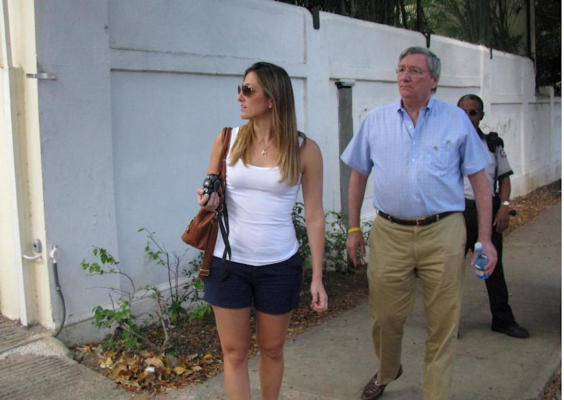 "Cuban exile Sergio Dalmau, right, walks on the sidewalk with his daughter Cecilia as they search for the childhood home of his ex-wife, Cecilia's mother, in the Miramar suburb in Havana, Cuba, Tuesday March 27, 2012. Dalmau left Cuba 51 years ago Thursday as part of the so-called ""Pedro Pan flights"" organized by the Roman Catholic Church to help spirit Cuban children off the island in the early 1960s. The two are part of a delegation of more than 300 mostly Cuban-American pilgrims visiting the island in honor of Pope Bennedict XVI's visit. (AP Photo/Laura Wides-Munoz)"