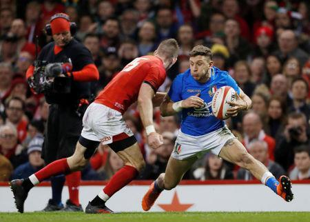 FILE PHOTO: Rugby Union - Six Nations Championship - Wales vs Italy - Principality Stadium, Cardiff, Britain - March 11, 2018 Wales' Liam Williams in action with Italy's Matteo Minozzi Action Images via Reuters/Paul Childs/File Photo