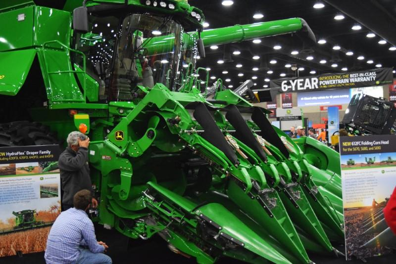 People look at Deere equipment as they attend National Farm Machinery show in Louisville
