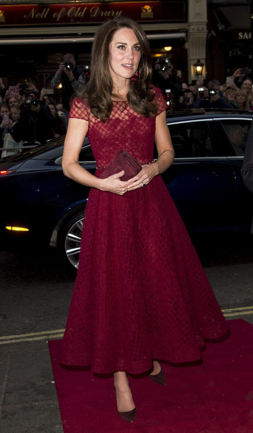 <p>Kate made a burgundy statement at a premiere in London, matching her dress, bag, shoes, and even her earrings. (Side note: She also kinda matches the carpet, lol.) </p>