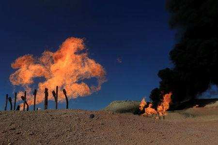 FILE PHOTO: Flames emerge from flare stacks at the oil fields in Dibis area on the outskirts of Kirkuk, Iraq October 17, 2017. REUTERS/Alaa Al-Marjani/File Photo