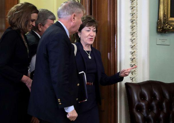 PHOTO: Sen. Susan Collins and Sen. Lindsey Graham are directed to a different entrance to the Senate Chamber before the start of President Donald Trump's impeachment trial at the U.S. Capitol, Jan. 21, 2020, in Washington, D.C. (Chip Somodevilla/Getty Images)