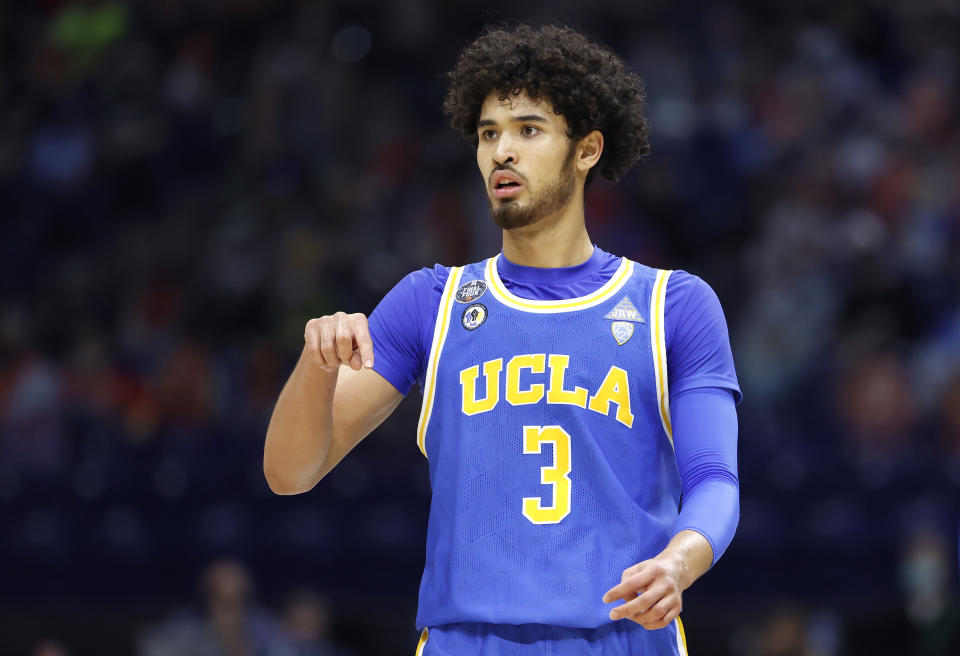 INDIANAPOLIS, INDIANA - APRIL 03: Johnny Juzang #3 of the UCLA Bruins reacts in the first half against the Gonzaga Bulldogs during the 2021 NCAA Final Four semifinal at Lucas Oil Stadium on April 03, 2021 in Indianapolis, Indiana. (Photo by Jamie Squire/Getty Images)