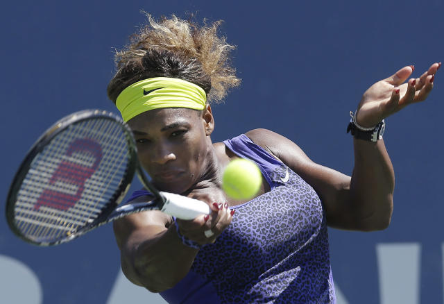 Serena Williams, of the United States, returns the ball to Andrea Petkovic, from Germany, during the second set of a semifinal in the Bank of the West Classic tennis tournament in Stanford, Calif., Saturday, Aug. 2, 2014. Williams won 7-5, 6-0. (AP Photo/Jeff Chiu)