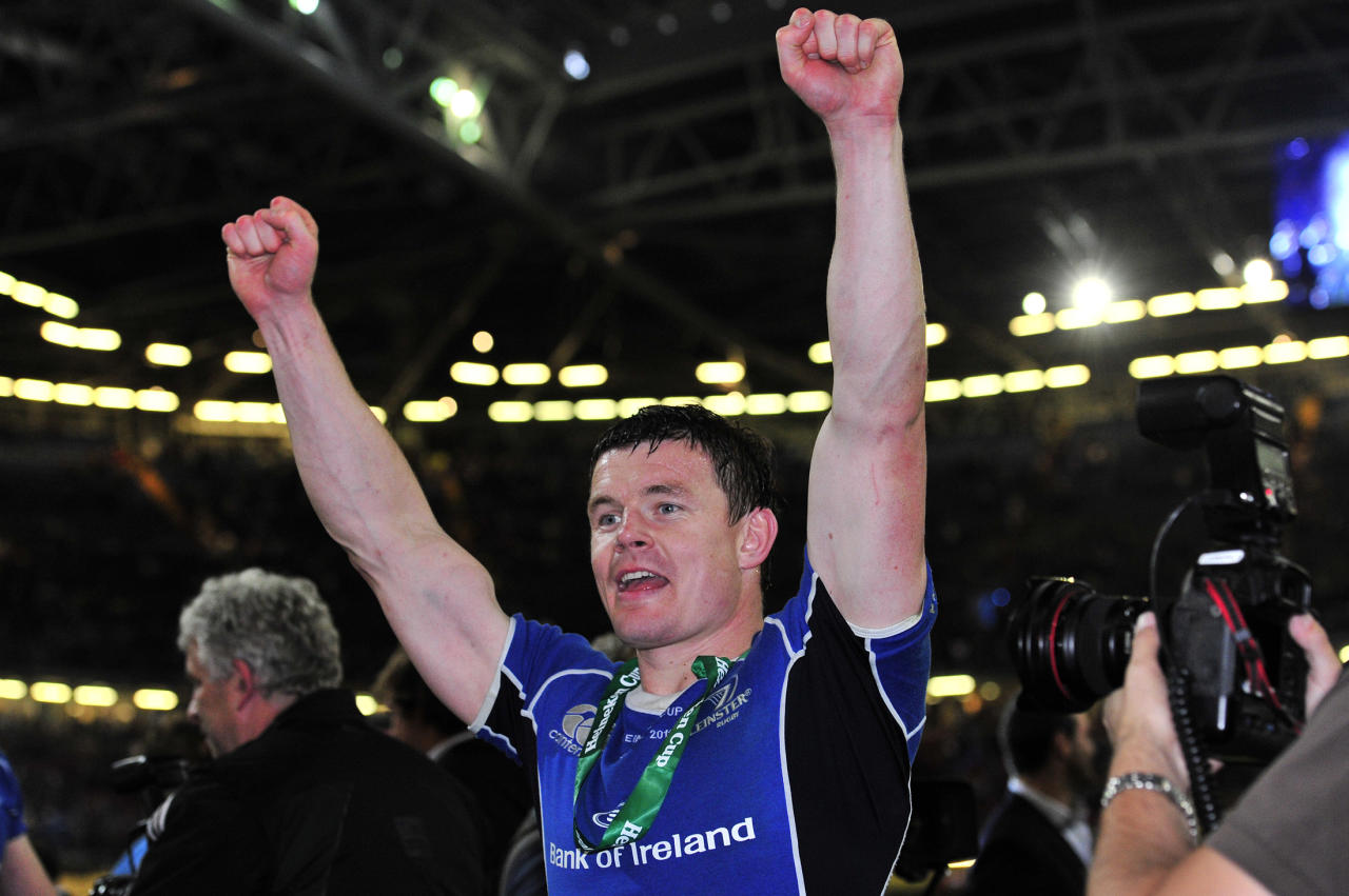 Leinster's Irish centre Brian Driscoll celebrates after his team wong their Heineken Cup Final match against Northampton Saints at the Millennium Stadium, Cardiff, Wales, on May 21, 2011. AFP PHOTO/GLYN KIRK NOT FOR MARKETING OR ADVERTISING USE/RESTRICTED TO EDITORIAL USE (Photo credit should read GLYN KIRK/AFP/Getty Images)