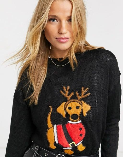 "<p>This cute little <a href=""https://www.popsugar.com/buy/Brave-Soul-Christmas-Sweater-Daschund-Applique-512982?p_name=Brave%20Soul%20Christmas%20Sweater%20With%20Daschund%20Applique&retailer=asos.com&pid=512982&price=21&evar1=fab%3Aus&evar9=32410225&evar98=https%3A%2F%2Fwww.popsugar.com%2Ffashion%2Fphoto-gallery%2F32410225%2Fimage%2F46862156%2FBrave-Soul-Christmas-Sweater-With-Daschund-Applique&list1=shopping%2Csweaters%2Choliday%2Cchristmas%2Cwinter%2Cwinter%20fashion%2Choliday%20fashion&prop13=api&pdata=1"" rel=""nofollow"" data-shoppable-link=""1"" target=""_blank"" class=""ga-track"" data-ga-category=""Related"" data-ga-label=""https://www.asos.com/us/brave-soul/brave-soul-christmas-sweater-with-daschund-applique/prd/12432569?clr=black&amp;colourWayId=16518219&amp;SearchQuery=christmas%20sweater"" data-ga-action=""In-Line Links"">Brave Soul Christmas Sweater With Daschund Applique</a> ($21, originally $41) is for the Ugly Christmas sweater party you don't actually want to look ugly for.</p>"
