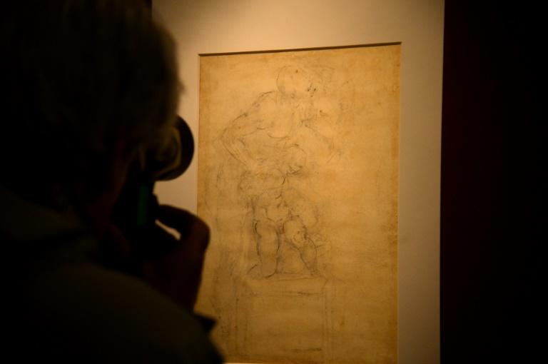 Visitors look at Michelangelo Buonarroti's drawing on paper in black pencil, red pencil and pen of 'The Sacrifice of Isaac' (Verso/back) in Rome's Capitolini Museums on April 21, 2017